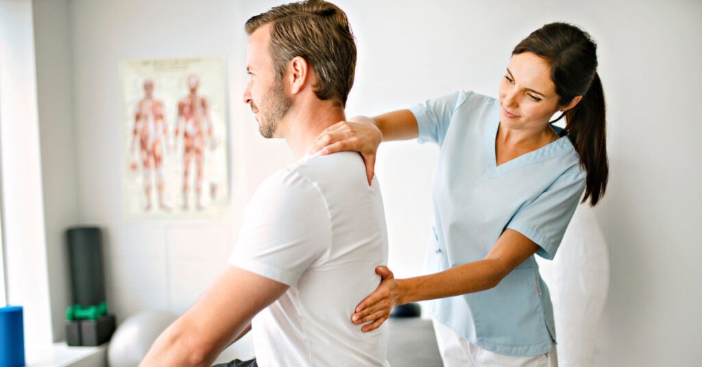 Chiropractor doing treatment on a patient in a bright room
