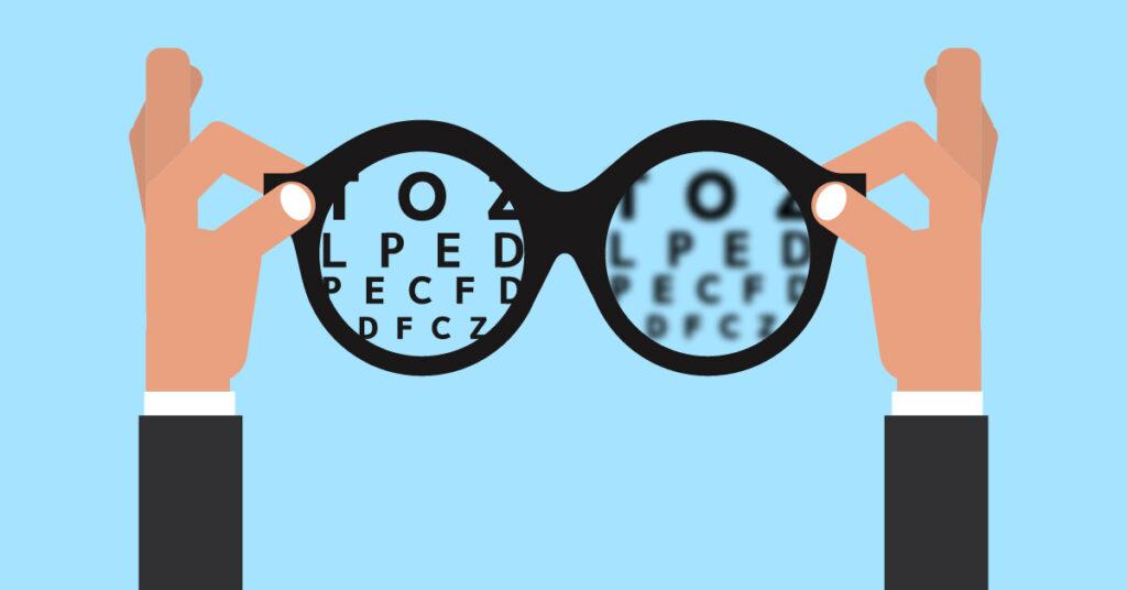 Prescription glasses over an eye exam