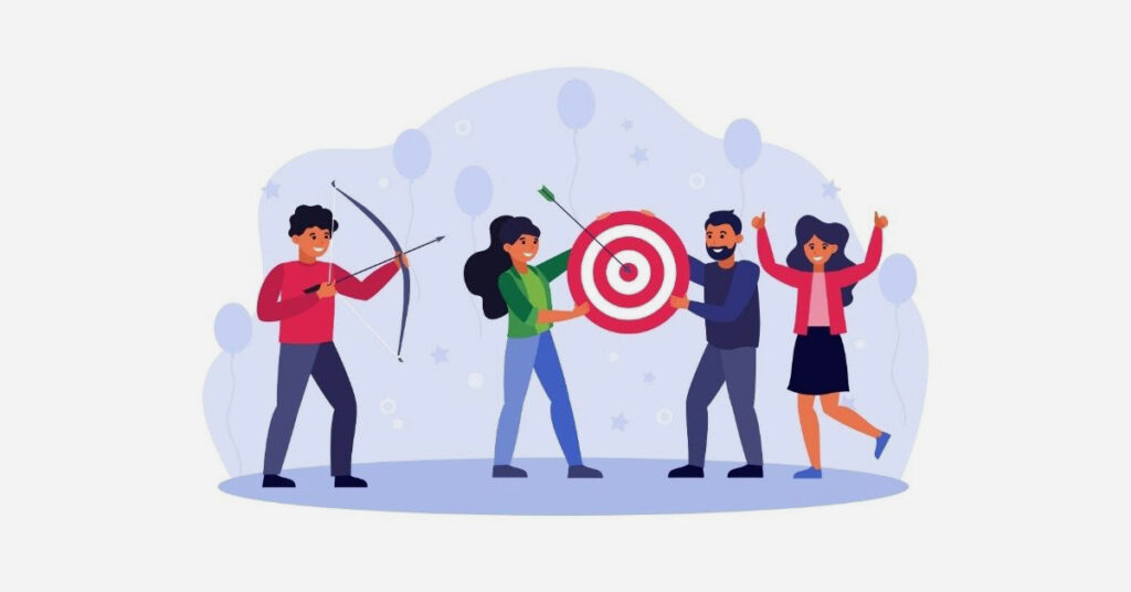A group of people hitting a bullseye on their target.